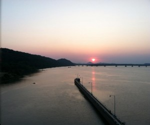 Pinnacle Mountain and sunset, looking west from the Big Dam Bridge.